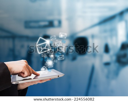 Businesswoman checking email in the subway station #224556082