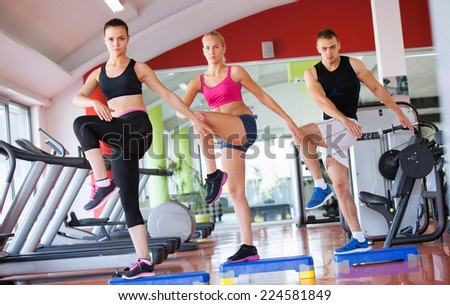 fitness, sport, training, gym and lifestyle concept - group of smiling people exercising in the gym #224581849