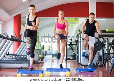fitness, sport, training, gym and lifestyle concept - group of smiling people exercising in the gym #224581861