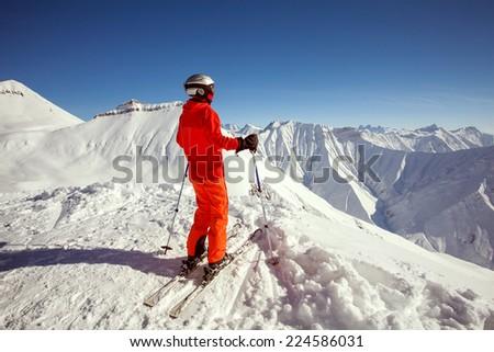 Skier is posing at camera at Gudauri resort in high mountaing of Georgia, Caucasus #224586031