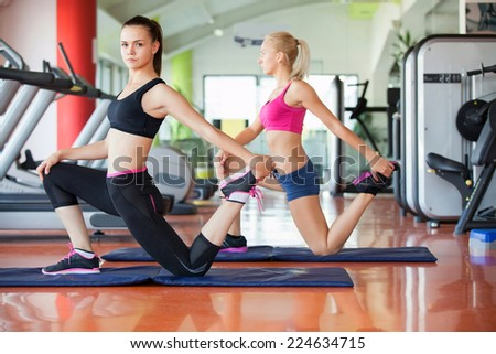 beautiful young women working out in the fitness studio #224634715
