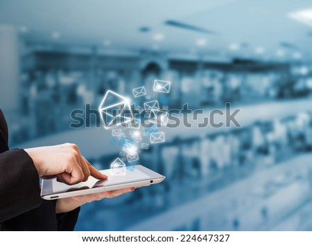 Businesswoman sending email in the shopping mall #224647327