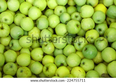 background of green apples on sale at the local market