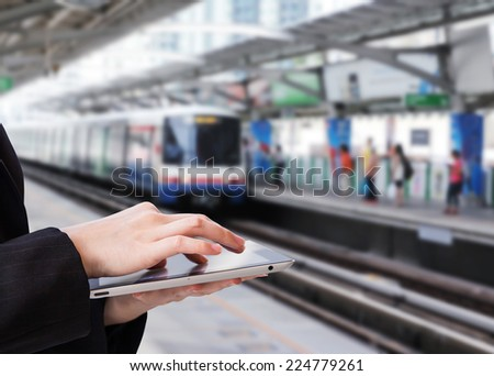 Businesswoman using digital tablet #224779261