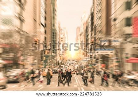 People on the street at Madison Avenue in Manhattan downtown before sunset in New York City - Commuters walking on zebra crossing during rush hour in american business district - Desaturated filter
