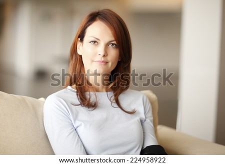 Close-up portrait of beautiful business woman sitting at home.  #224958922