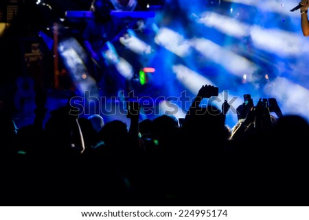 People taking photographs with touch smart phone during a music entertainment public concert #224995174