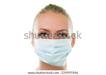 Face of a doctor woman wearing hospital mask with white background #224995966