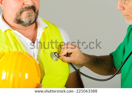 laborer hart hat at medical doctor examination isolated background #225063388