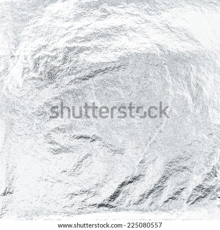 Thin sheet of silver leaf background with shiny uneven surface  Royalty-Free Stock Photo #225080557