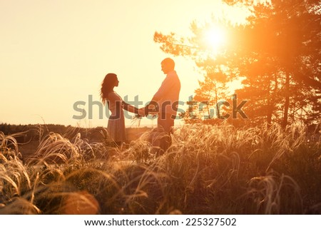Young couple holding hands at sunrise #225327502
