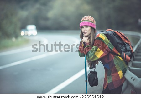 Beautiful young woman traveling. toned dark dramatic image #225551512