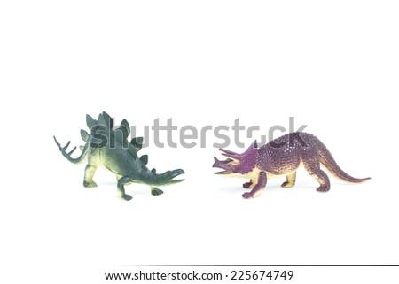 Triceratops and Stegosaurus dinosaur toy on white background #225674749