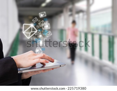 Businesswoman checking email by using digital tablet #225719380