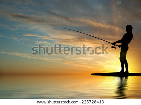 Silhouette of teenager girl fishing at sunset #225728413