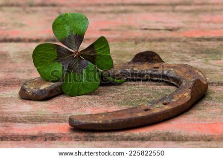 horseshoe and four leaf clover on wood #225822550