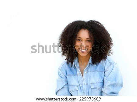 Close up portrait of an attractive young black woman with curly hair smiling on isolated white background #225973609