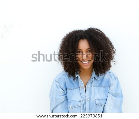 Close up portrait of a happy young african american woman smiling on whit background #225973651