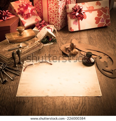 Old letter with feather pen and glasses, gifts and christmas tree on background. #226000384