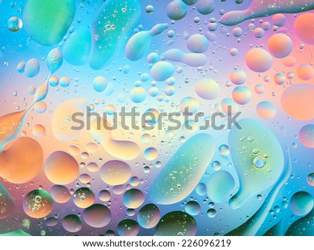 macro of oil mixed with water on colorful background