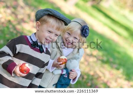 Happiness children eat apples outdoors #226111369