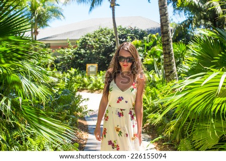 Young beautiful woman on summer vacation at lush garden #226155094