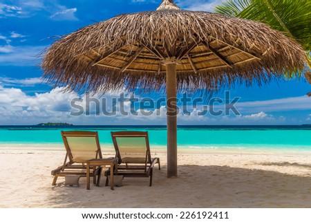 Dreamy beach with sun loungers under a beach umbrella at Maldive #226192411