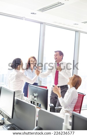 Businesspeople celebrating success in office #226236577