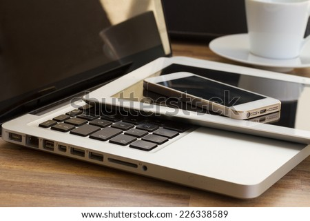 modern computer gadgets  - laptop, tablet and phone close up Royalty-Free Stock Photo #226338589