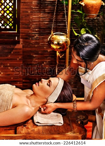 Young woman having oil Ayurveda spa treatment. #226412614