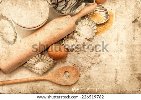 baking ingredients and tolls for dough preparation. flour, eggs, sugar, rolling pin and cookie cutters on white background. retro style picture