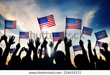 Group of People Waving American Flags at Sunset #226614211