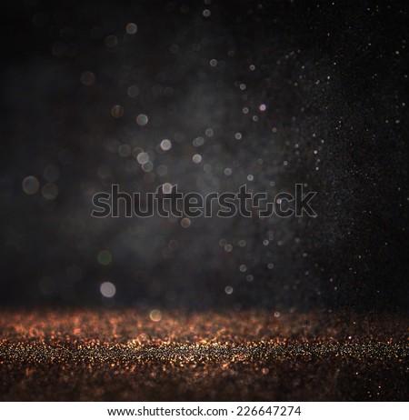 dark glitter vintage lights background. gold and black. defocused.