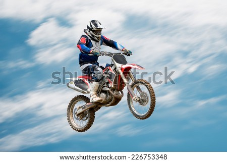biker making stunt and jumps in the air