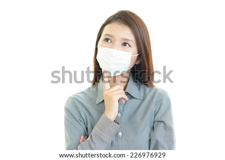 Young woman with face mask having cold #226976929