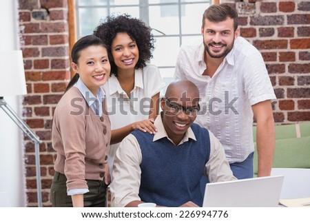 Happy creative business team using laptop in meeting at office #226994776