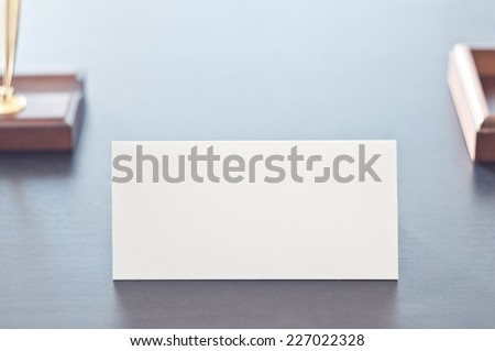 White triangular sign for the label standing on a table. Room for you text. #227022328