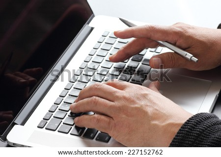 Male hands typing on a laptop #227152762
