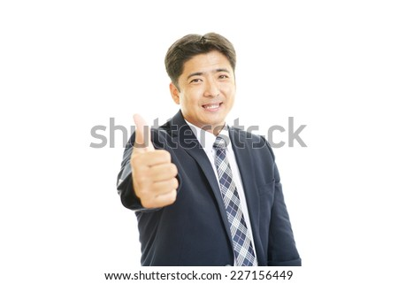 Smiling businessman with thumbs up #227156449