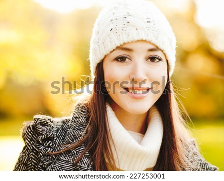 Beautiful girl smiling and enjoying winter sunshine #227253001