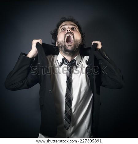 Desperate businessman shouting #227305891