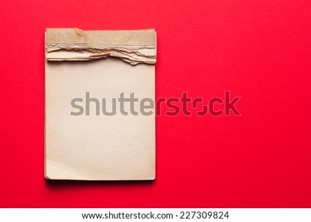 old notebook on red background  #227309824
