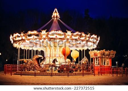 illuminated retro carousel at night Royalty-Free Stock Photo #227372515