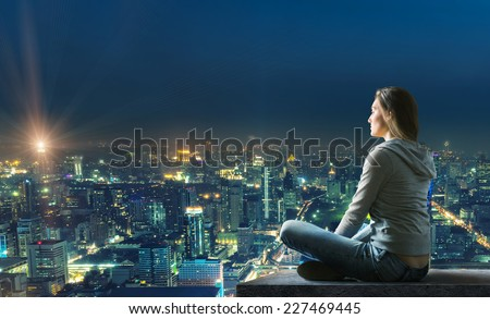 Woman is sitting over the city #227469445