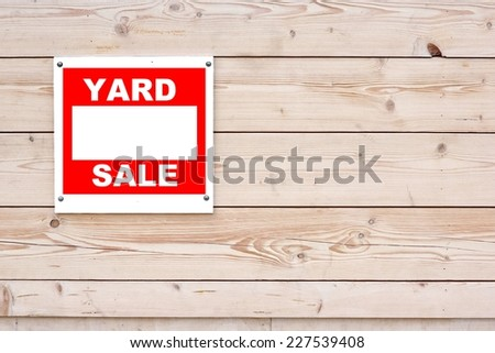 Yard Sale Sign on Natural Wood Wall