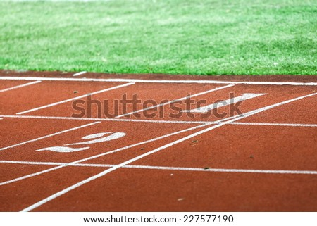 Running track numbers  in stadium #227577190