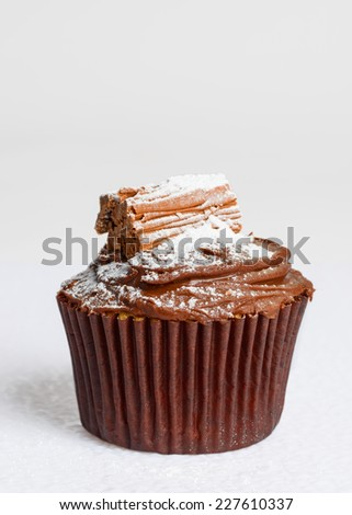 Chocolate cake decorated with a flake on a white background #227610337