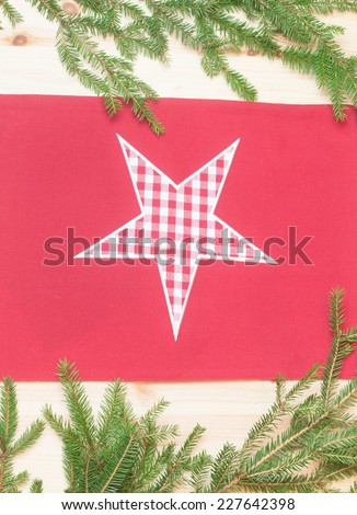 Star towel  on wooden background with spruce branches #227642398