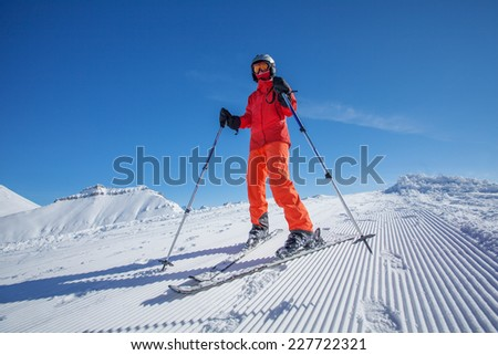 Skier is posing at camera at Gudauri resort in high mountaing of Georgia, Caucasus #227722321