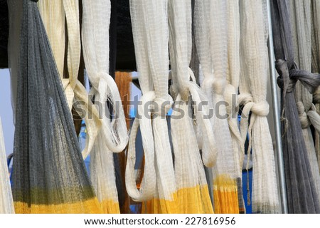 suspension of fishing nets in the market, closeup of photo #227816956